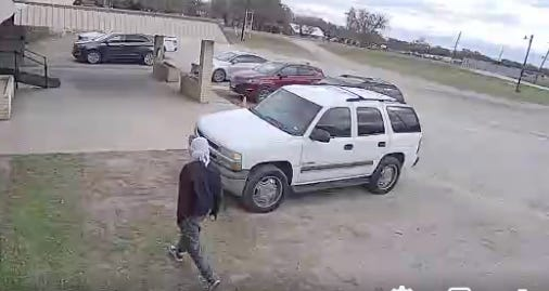 A still from a surveillance video shows the man Early police believe is the suspect who fired two shots into the Travelers Game room Wednesday.