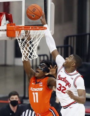 Ohio State forward E.J. Liddell, here defending Illinois guard Ayo Dosunmu, finished second on the team in scoring (16.2 points per game) and first in rebounding (6.7) and was named first-team all-Big Ten.