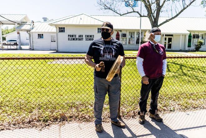 Albert Naquin of the Isle de Jean Charles Biloxi-Chitimacha-Choctaw Indians and Donald Dardar of the Pointe-au-Chien Indian Tribe lead drumming and singing during a protest April 1 outside Pointe-aux-Chenes Elementary School. The tribes are opposing a plan by Terrebonne Parish school officials to close the school amid dwindling enrollment.