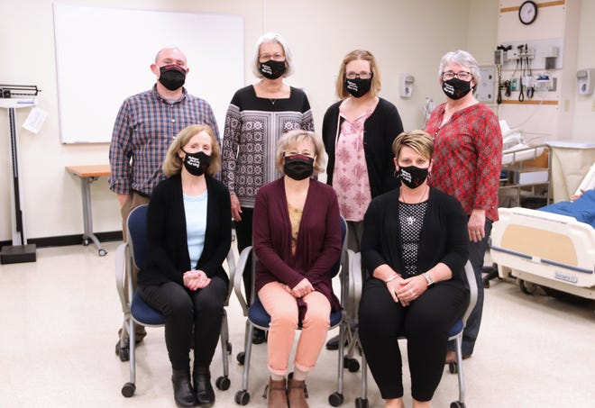 The Muskingum University nursing faculty includes, from left front, Michele Miller,Janelle Guentter, Terra Armstead, back, Joe Shaeffer, Cynthia Wilkins, Mary Coury, and Jennifer McCarty.