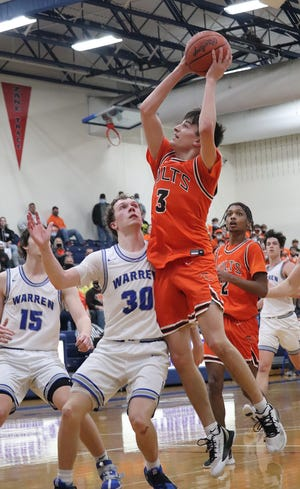 Meadowbrook junior Jake Singleton takes the ball to the basket during Division II regional semi-final action against Warren High at Southeastern High School