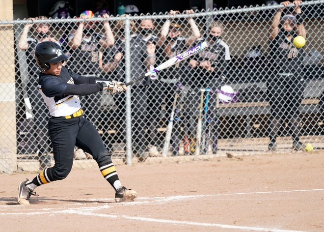 Adrian College's Destiny Rogers gets a hit during a game against Defiance earlier in the 2021 season.