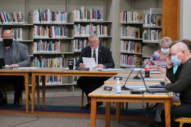 Tecumseh Public Schools Superintendent Rick Hilderley reads a prepared statement about the invalidation of the appointment of former school board president Kevin Johnson to the board at a meeting Tuesday.