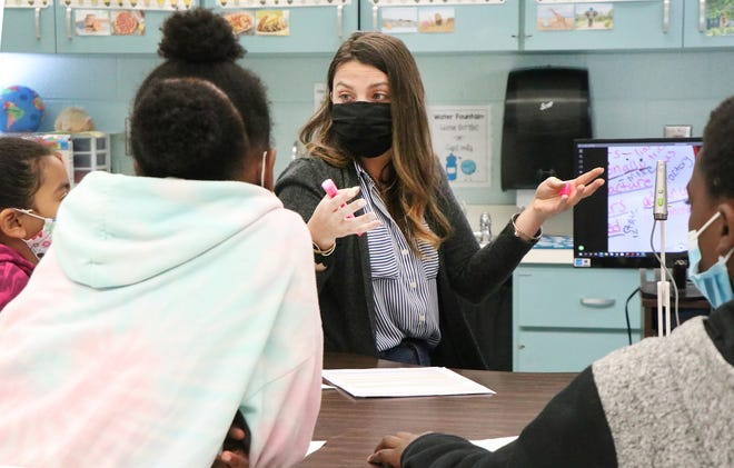 Teacher Kelli Gunkle works with a small group of students in her third grade class, Wednesday March 31, 2021 at Palm Terrace Elementary in Daytona Beach. Gunkle makes sure to teach her students about self esteem, problem solving and communication as well as academics.