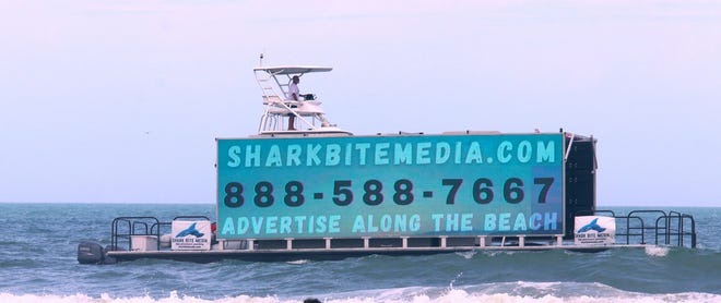 The Shark Bite Media advertising water billboard craft works along the Volusia County beaches, Wednesday March 31, 2021 from Ponce Inlet to Ormond.
