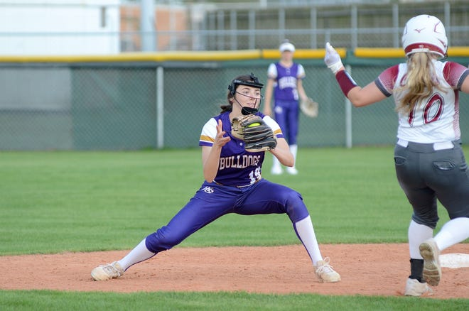 Ascension Catholic senior shortstop Mackenzie Marroy tags out an E.D. White runner at second base March 30, in Donaldsonville.