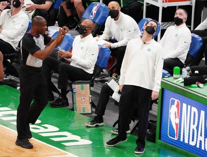 Mar 31, 2021; Boston, Massachusetts, USA; Boston Celtics head coach Brad Stevens (right) reacts to a call from the sideline as they take on the Dallas Mavericks during the second quarter at TD Garden.