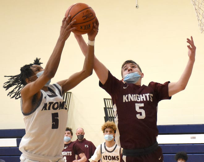 Frankfort-Schuyler Maroon Knight Jeffrey DeSarro (left) and Utica Academy of Science Atom Justin Brown grab for a rebound during the second half Wednesday.