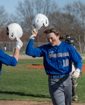 Truman High School's Brady Ruks-Bond gets congratulations after his home run Wednesday in the Patriots' 9-7 loss to North Kansas City.