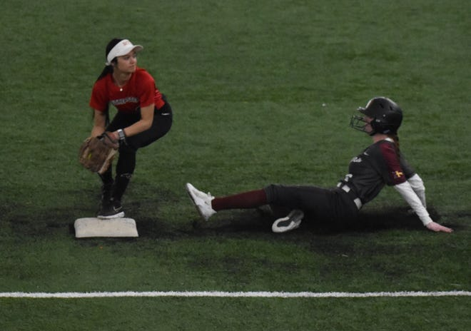 Southeastern Community College second baseman Makayka Cam forces Indian Hills' Bryanna Mehaffy out at second in the fifth inning of Wednesday's first game at The FunCity Turf. Cam's throw to first base was too late to turn a double play. The two teams split the doubleheader.
