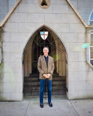 Trinity Parish pastor Matthew Marino stands in front of the original entrance to the church that is celebrating its bicentennial this year.