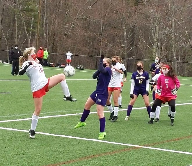 Worcester South's Kathyrn Shannon (18) attempts to play the ball in the air in front of Monty Tech's Mabel Matheson during a Bulldogs corner kick, Thursday, at Game On Sports & Performance Center in Fitchburg.