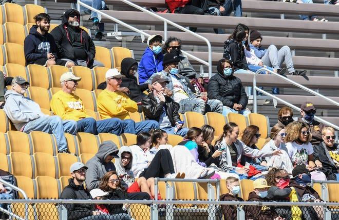 A group of Garden City Community College football fans watch the Broncbusters in their season opener Saturday at Broncbuster Stadium.