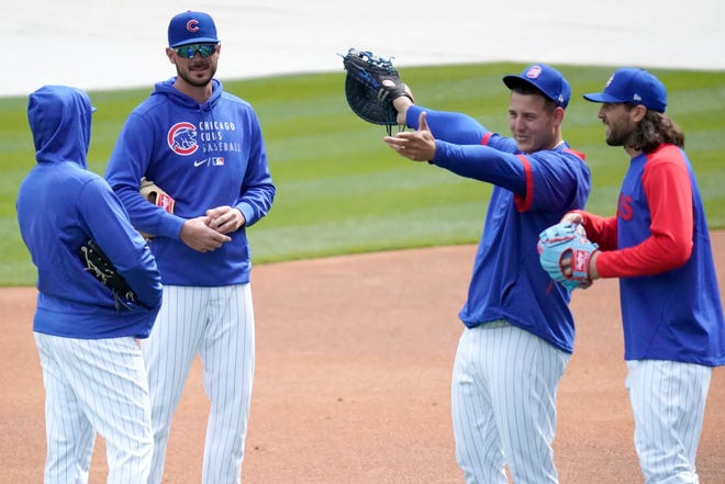 Chicago Cubs third baseman Kris Bryant, second from left, talks to Ian Happ, left, as first baseman Anthony Rizzo shows center fielder Jake Marisnick Wrigley Field during the team's last baseball workout Wednesday, March 31, 2021, before opening day Thursday, April 1, 2021, against the Pittsburgh Pirates in Chicago.