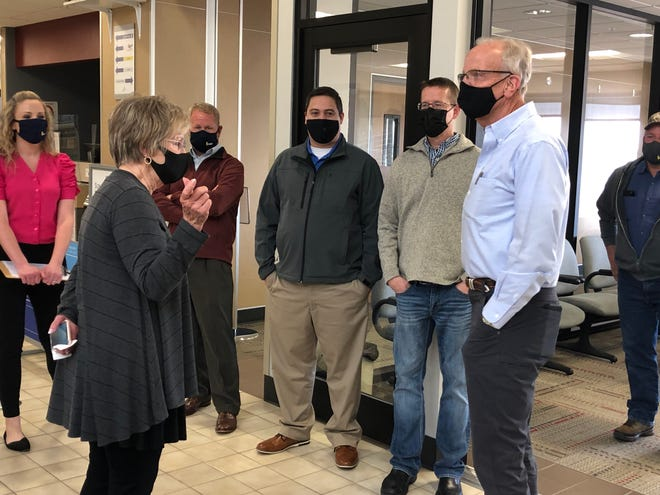 Hays Mayor Sandy Jacobs, foreground left, speaks with Kansas Sen. Jerry Moran, right, at the Hays Regional Airport on Tuesday afternoon. In the background, from left, are airport manager Jamie Salter, city manager Toby Dougherty, and city commissioners Mason Ruder and Shaun Musil.