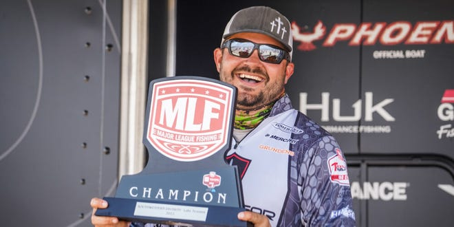 Evan Barnes, the winner of the MLF Big 5 Toyota Series tournament on Lake Texoma last weekend, is all smiles after collecting the trophy and $40,000-plus paycheck.