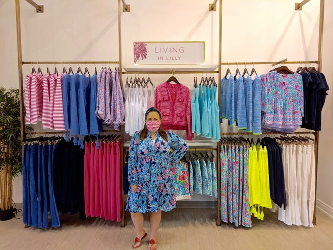 Kathryn Heston, owner of Postcards from Paradise, poses for a photo shortly after opening her doors for the first time Thursday, April 1, in downtown Holland.
