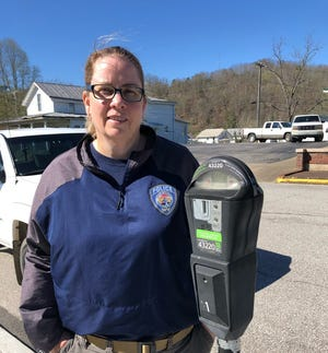 Cutline: Ripley's parking enforcement officer, Cheryl Crawford, encourages drivers to use the Pay by Phone app.