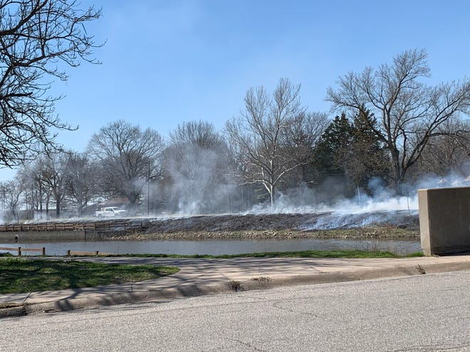 It was no April Fool's joke in Newton, the creeks of Sand Creek were on fire the morning of April 1. Part of a prescribed burn that limits volunteer tree growth along the banks which were restored by the Army Corps of Engineers several years ago.