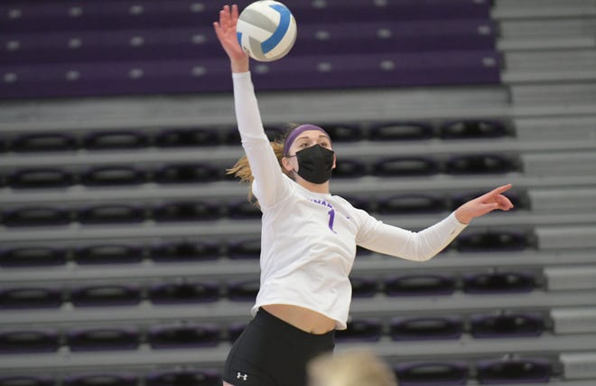 Truman senior outside hitter Ellie Kaat goes up for a kill during a spring 2021 season match against Missouri-St. Louis.