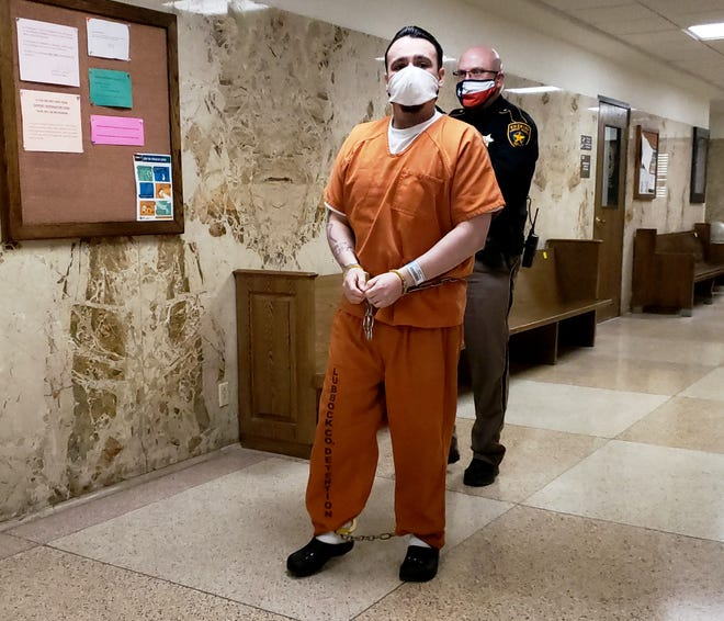 A Lubbock County Sheriff's Deputy escorts Joseph Gonzalez Jr. on Thursday to the 364th District Court where he was called by prosecutors to testify in the aggravated robbery trial of his brother and co-defendant, Phillip Velazquez.