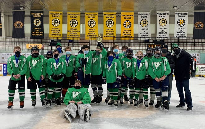 Members of the division champion middle school Wachusett Green team, which won in OT.