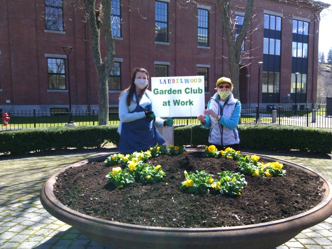 Kathryn Nowosielski, left, president of the Laurelwood Garden, and Julie Palioca, Beautification Chairperson and coordinator of the Memorial Planter.