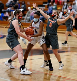 Summerfield's Abby Haller (left) and Elaney Fisher (right) double team Kayla Webber of Southfield Christian during the Division 4 Regional finals Wednesday, March 31, 2021.