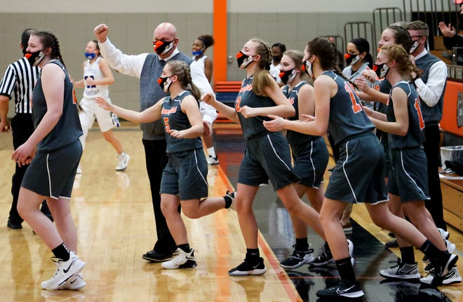 Summerfield's girls basketball team rushes onto the court to celebrate as Bulldogs defeated Southfield Christian 66-35 in the Division 4 Regional finals Wednesday, March 31, 2021.