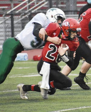 Sauquoit Valley's Andrew Walker fights for more yardage against Westmoreland/Oriskany during a game in the shortened spring season. Walker is a key returner for the team this fall.