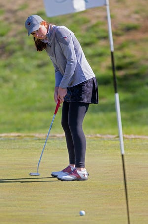 Edmond Memorial's Lilly Whitley hits a shot during a tournament at Rose Creek Golf Course in Edmond on Thursday.