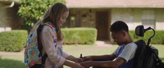 "Austyn Johnson, left, and Paul-Mikél Williams appear in the Oklahoma-made movie ""The Girl Who Believes in Miracles."""
