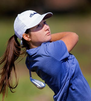 Edmond North's Haley Blevins hits a shot on April 1 at Rose Creek Golf Course in Edmond.