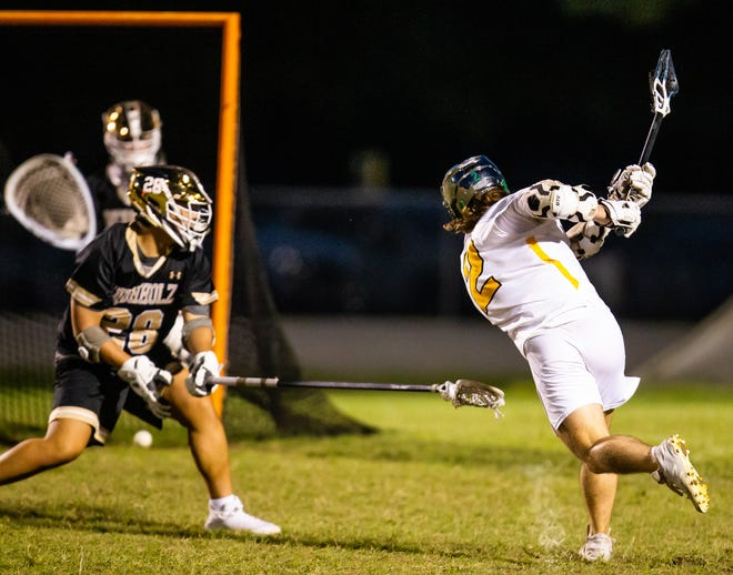 Forest #2 Drew Flagg scores in the first half to make 4-2 Forest. The Buchholz Bobcats played the Forest Wildcats in boys lacrosse Wednesday night, March 31. 2021 at Forest High School in Ocala, FL.  [Doug Engle/Ocala Star Banner]2021