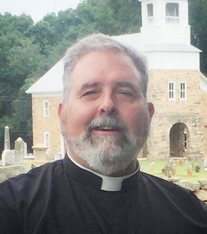 Rev. Carlin Ours