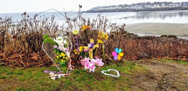 Memorial flowers placed near Short Sands Beach in York, Maine, honor the life of 35-year-old Rhonda Pattelena of Bedford, Massachusetts, who died at the beach Friday, March 26, 2021, after allegedly being attacked by 33-year-old Jeffrey Buchannan, the father of one of her three sons.