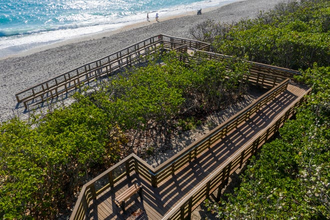 The town of Jupiter redesigned three of its beach crossovers to comply with the Americans with Disability Act. Access No. 48, is complete with gradually sloping ramps, hand railings and landing areas in Jupiter, Florida on March 30, 2021.