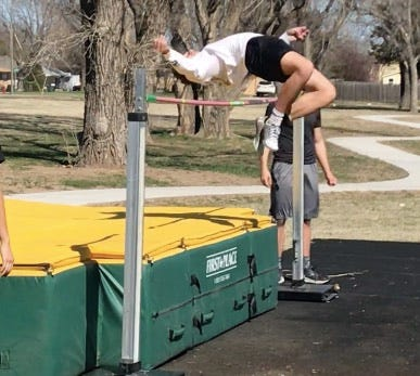 Carson Hoeme, Pratt sophomore, practices high jump at the start of spring track and field season.