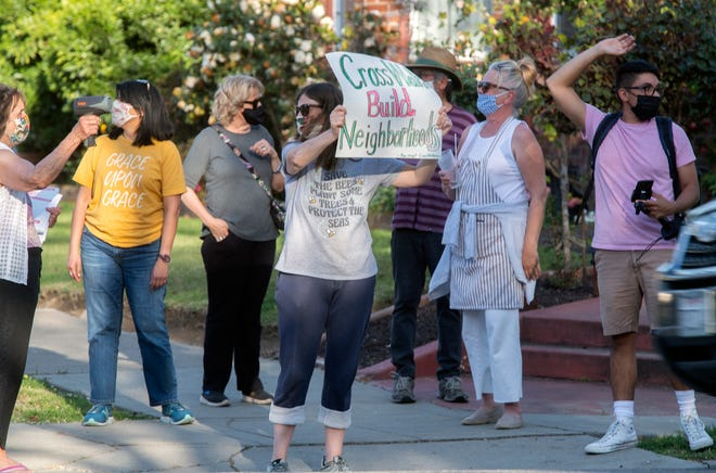 Residents protest for a reinstalling of a crosswalk on Pershing Avenue and Rose Street across from Victory Park in Stockton.