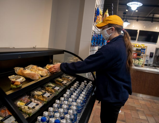 Kayla McMillen, cashier at the Golden Flash Bistro which is located on the ground floor of the Student Center. Dining services will be reworked this spring as Kent State takes over their operations.