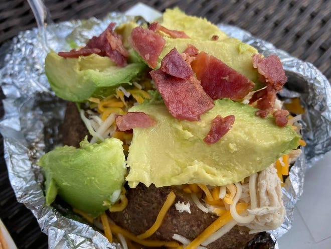 """The """"California Club"""" is among the baked potato menu selections at Simply Spuds, a startup food trailer business in Stark County."""