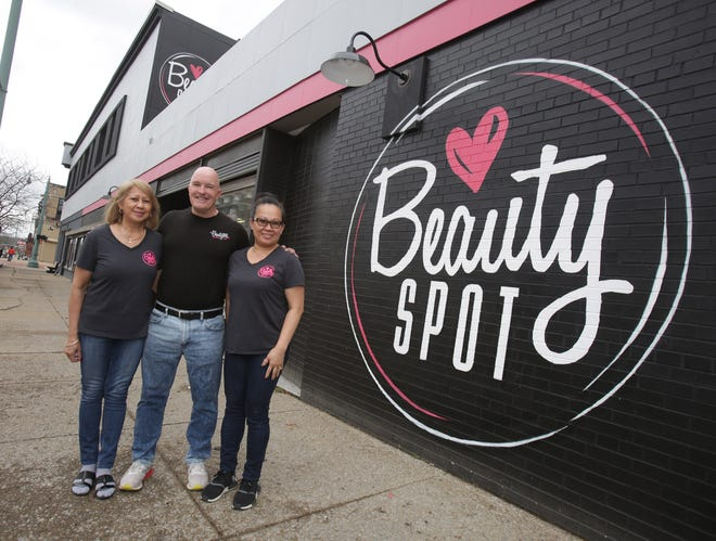 David Beck, owner of the Beauty Spot, along with employees Jasmine Ollis  (left) and Lanie Griffith, outside the downtown Canton store.