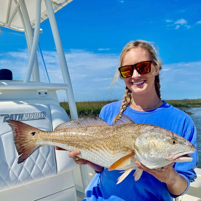 Anna Sauer with a pretty redfish caught with Captain Rob Bennett earlier this week.