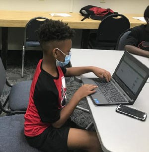 Club member Kaiden Camp-Byers works on his virtual homework assignments at the Boys & Girls Club.