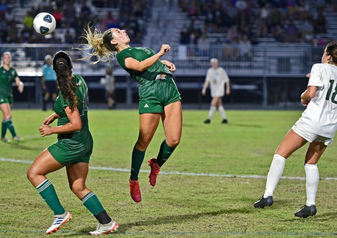 Venice High's Olivia Fair (3) fields a head-shot against Fleming Island during a state semifinal playoff game at Venice's Powell-Davis Stadium on Feb. 26. Fair, a four-year starter, anchored a defense that allowed just three goals in four playoff matches and 19 goals in 21 matches for the season.