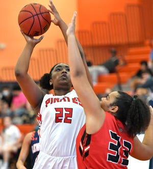 Port Charlotte High's Alysa Taylor shoots against Pirates teammate Taniya Fisher during an All-Star girls basketball game at Lemon Bay High  Wednesday night.
