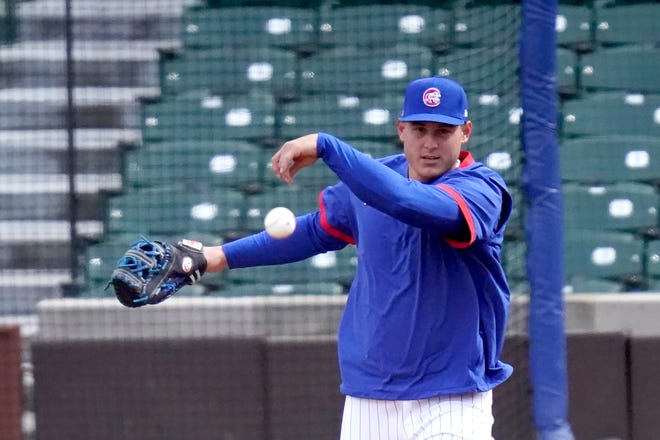 Chicago Cubs first baseman Anthony Rizzo throws during the team's last baseball workout Wednesday, March 31, 2021, before the home opener Thursday, April 1, 2021, against the Pittsburgh Pirates in Chicago.