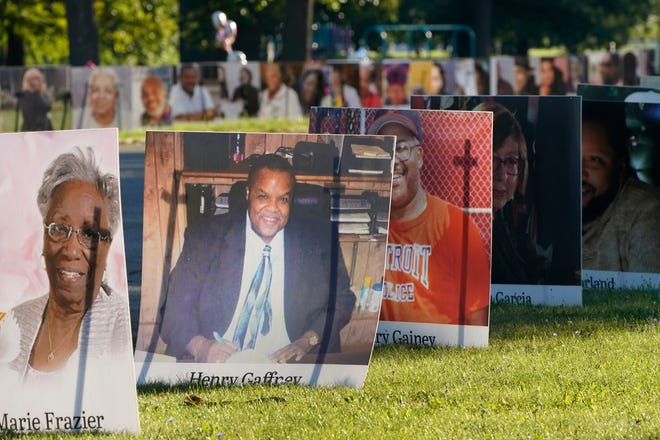 FILE - In this Monday, Aug. 31, 2020 file photo, some of the nearly 900 large poster-sized photos of Detroit victims of COVID-19 are displayed on Belle Isle in Detroit. The COVID-19 pandemic pushed total U.S. deaths last year beyond 3.3 million, the nation's highest-ever annual death toll, the government reported Wednesday, March 31, 2021. (AP Photo/Carlos Osorio)