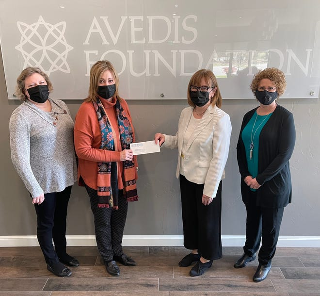 From left, Tracy Meeuwsen, Avedis Foundation program director;  Avedis President & CEO Dr. Kathy Laster; Jo Wise, regional director of Junior Achievement of Oklahoma; and Shannan Beeler,  Junior Achievement of Oklahoma president, pose for a photo. Avedis just gave the nonprofit a $10,000 grant for education support.
