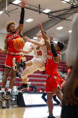 Dallen Forsythe (10) drives the ball to the hoop.